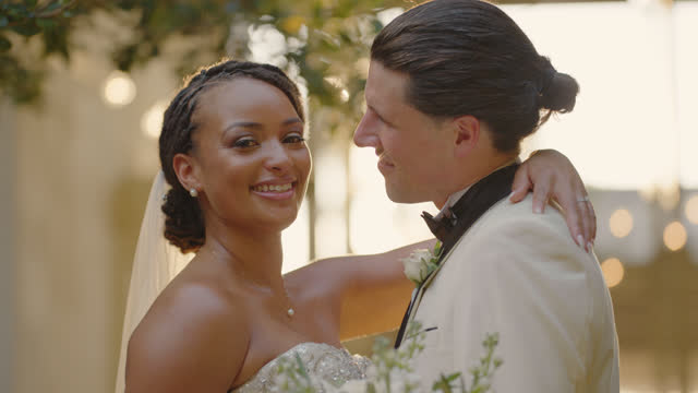 slo mo cu portrait of a gorgeous bride with her husband - bunch of flowers stock videos & royalty-free footage