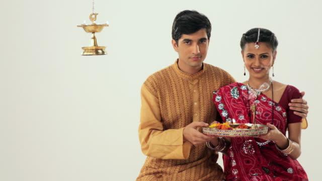 Portrait of a gujrati couple praying