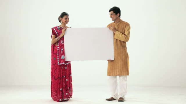 Portrait of a gujrati couple showing a placard