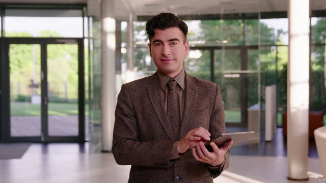 portrait of a handsome young businessman with digital tablet - formal businesswear stock videos & royalty-free footage