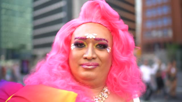 portrait of a happy and confident drag queen at pride parade - pink colour stock videos & royalty-free footage