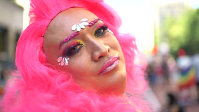 portrait of a happy and confident drag queen at pride parade - fascino video stock e b–roll