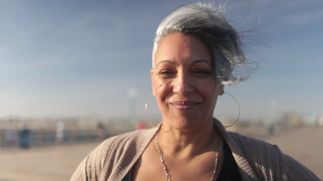 portrait of a happy black woman at the beach - western usa stock videos & royalty-free footage