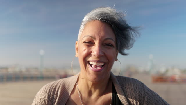 portrait of a happy black woman at the beach - smiling stock videos & royalty-free footage