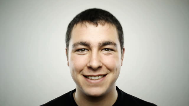 portrait of a happy caucasian real young man - studio shot stock videos & royalty-free footage