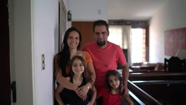 portrait of a happy family at home - mid adult stock videos & royalty-free footage