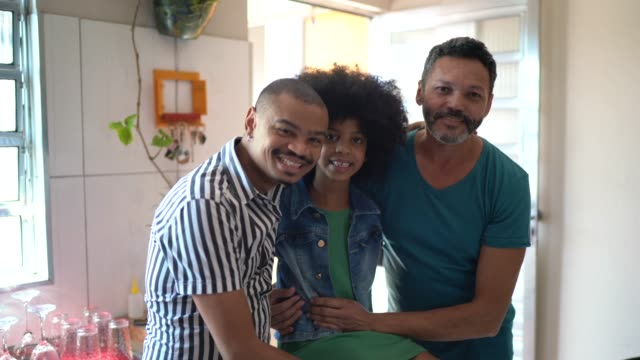 portrait of a happy family embracing at home - genderblend stock videos & royalty-free footage