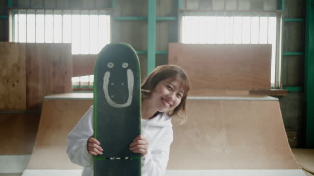 portrait of a happy japanese skateboarder - attitude stock videos & royalty-free footage
