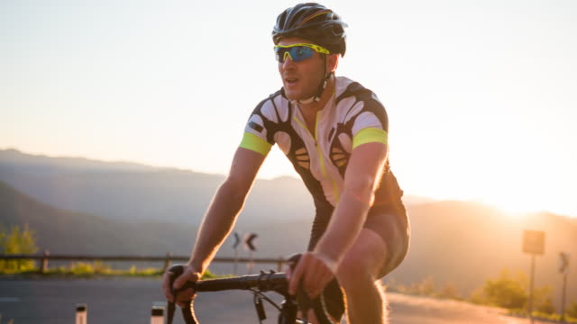 portrait of a happy road cyclist - racing bicycle stock videos and b-roll footage
