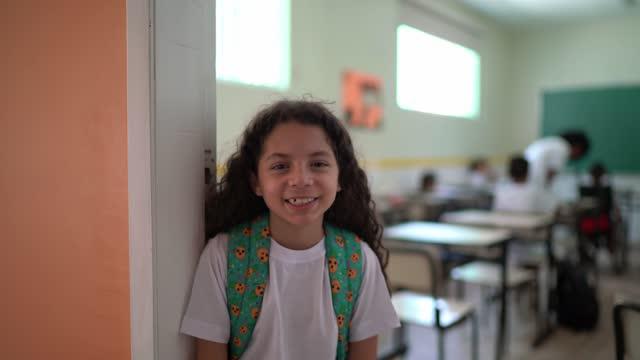 portrait of a happy schoolgirl at school - school uniform stock videos & royalty-free footage