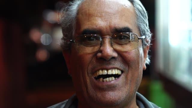 portrait of a happy senior man looking at the camera - pardo brazilian stock videos & royalty-free footage
