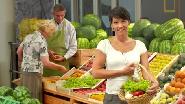 hd: portrait of a happy woman in greengrocer's shop - antioxidant stock videos & royalty-free footage