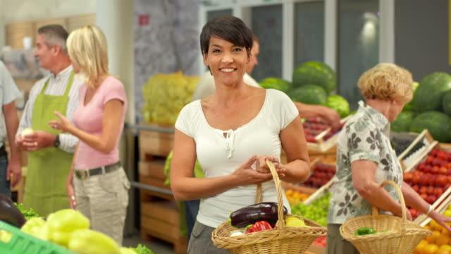 HD: Portrait Of A Happy Woman In Grocery Store