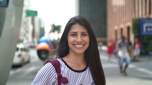 portrait of a happy young woman - avenida paulista stock videos & royalty-free footage
