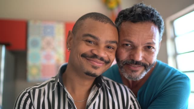 portrait of a homosexual couple at home - black ethnicity stock videos & royalty-free footage