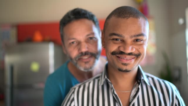 portrait of a homosexual couple at home - gay couple stock videos & royalty-free footage