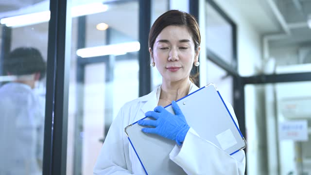 portrait of a japanese female researcher working at a research facility. - hospital stock videos & royalty-free footage