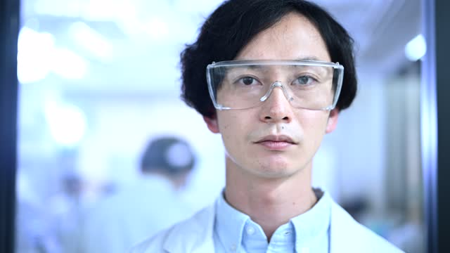 portrait of a japanese male researcher working at a research facility. - one mid adult man only stock videos & royalty-free footage