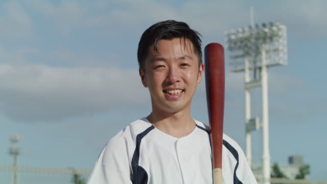 portrait of a japanese man wearing a baseball outfit - bronek kaminski stock videos & royalty-free footage