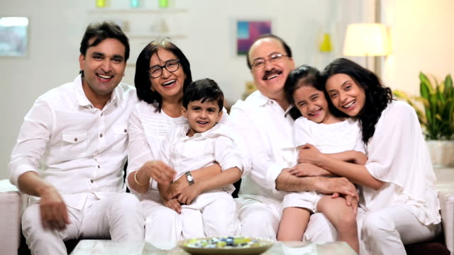 portrait of a joint family smiling in home, delhi, india - large family stock videos and b-roll footage