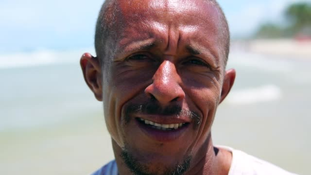 portrait of a latin adult man on the beach - pardo brazilian stock videos & royalty-free footage