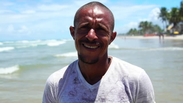portrait of a latin adult man on the beach - pardo brazilian stock videos & royalty-free footage