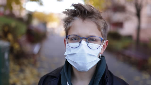 portrait of a little boy during the covid-19 pandemic - childhood stock videos & royalty-free footage