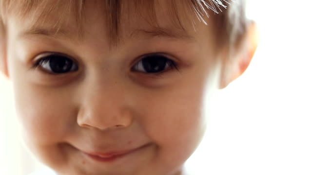 portrait of a little boy in slow motion - solo un bambino maschio video stock e b–roll