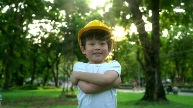 Portrait of a little boy in with safety helmet.The concept of real estate and engineering.