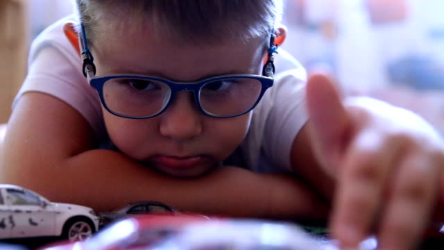 portrait of a little boy playing with cars - wooden floor stock videos & royalty-free footage