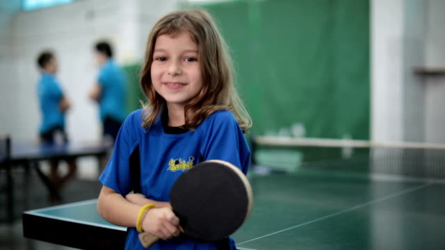 portrait of a little girl holding a table tennis racket - table tennis stock videos & royalty-free footage