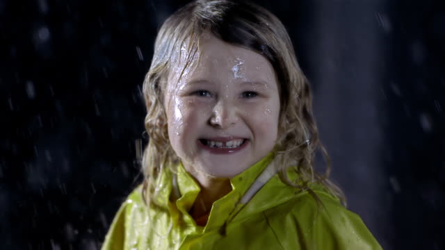 Portrait Of A Little Girl In The Rain