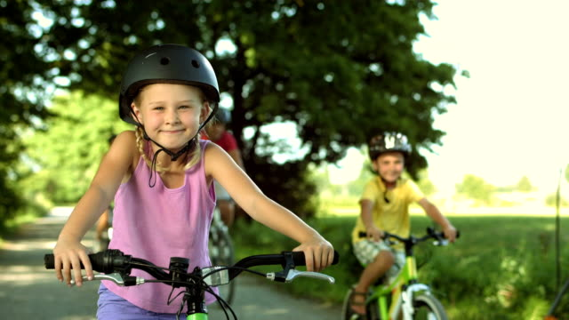 HD: Portrait Of A Little Girl On Bicycle