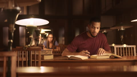 ds portrait of a male african-american student studying in the library - library stock videos & royalty-free footage