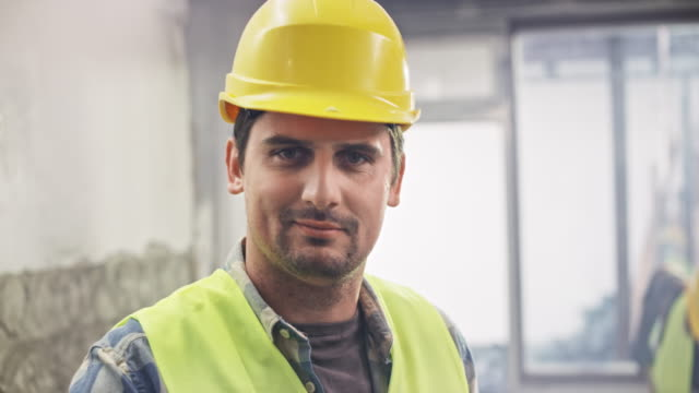 portrait of a male construction worker - plaster stock videos and b-roll footage