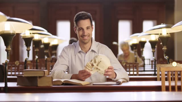 DS Portrait of a male medical student studying in library