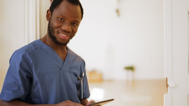 portrait of a male nurse at private clinic - male nurse stock videos & royalty-free footage