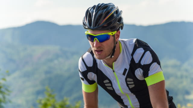 portrait of a male road cyclist during sports training - out of breath stock videos and b-roll footage