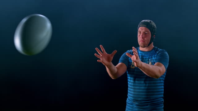 slo mo portrait of a male rugby player catching the ball - rugby stock videos & royalty-free footage