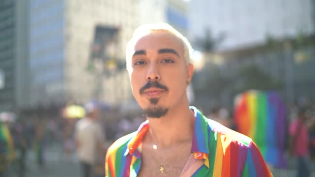 portrait of a man during lgbtqi parade - gay pride stock videos & royalty-free footage