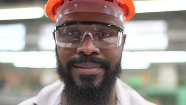 portrait of a man in a factory - helmet stock videos & royalty-free footage