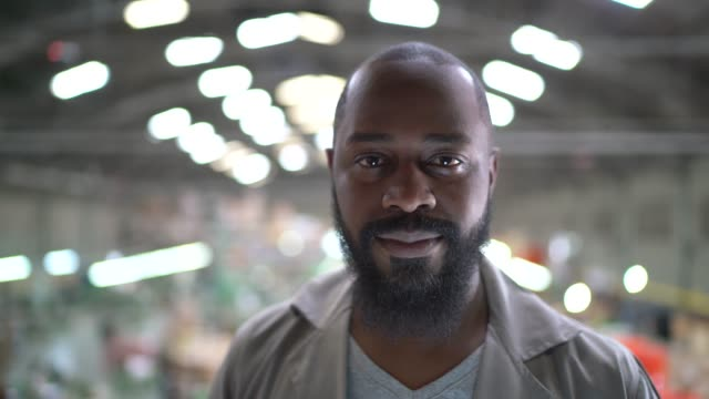 portrait of a man in a factory - completely bald stock videos & royalty-free footage