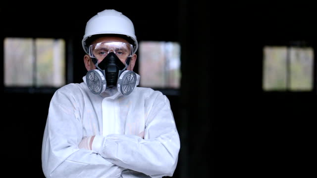 portrait of a man in protective workwear. - arms crossed stock videos & royalty-free footage