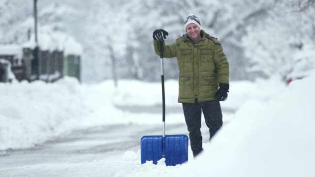 HD: Portrait Of A Man Shoveling The Snow