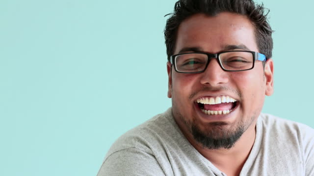 portrait of a man smiling - coloured background stock videos & royalty-free footage