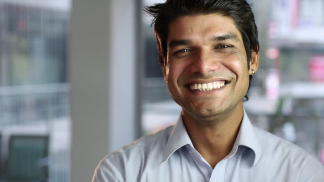 portrait of a man smiling - indian ethnicity stock videos & royalty-free footage