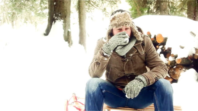 portrait of a man taking a rest in snow-capped landscape, bavaria, germany - hot drink stock videos and b-roll footage