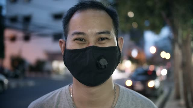 portrait of a man wearing face mask. coronavirus concept - asian man coughing stock videos & royalty-free footage