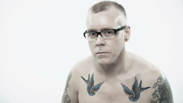 portrait of a man with tattoos and eyeglasses - white background stock videos & royalty-free footage