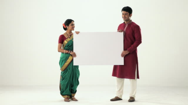 portrait of a marathi couple showing placard  - placard stock videos & royalty-free footage